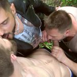 hans berlin gives a blowjob outdoors while two men are kissing