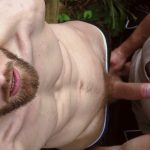 handsome man with beard gets a blowjob outdoors