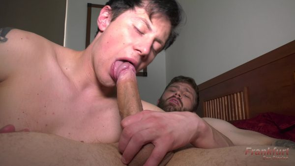 dark haired young man blows very big cock
