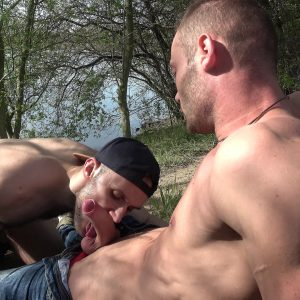 sexy guy sits on the ground outdoors and gets a blowjob