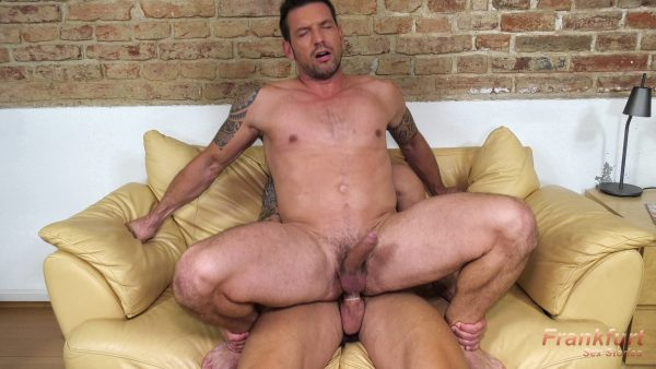muscle guy hooked on a sofa riding a big cock