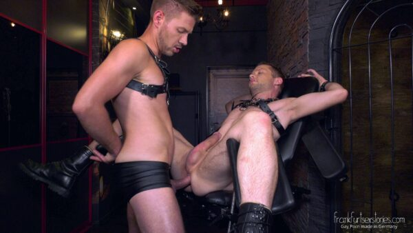 lederkerle stud in leather on a chair gets anal penetration by leather guy