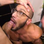 submissive gay guy with glasses is on his knees sucking big cock