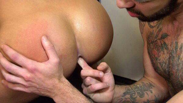 tattooed hairy guy with beard sticks his finger in male asshole