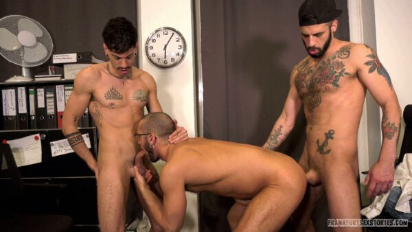 guy with glasses gets fucked by two sexy tattooed studs in the office