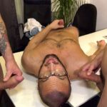 hairy guy with glasses gets cumshots on his face by two big cocks