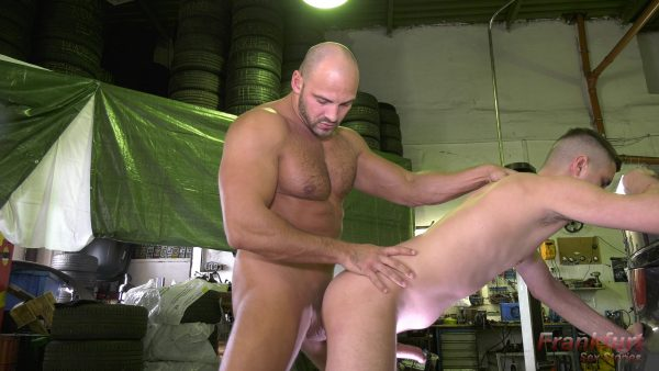 young man gets fucked doggy by muscle man with big cock