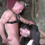 young man in leather pants blows a blond muscle stud
