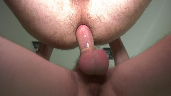 big dick with a condom on penetrates male hairy asshole