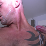 guy with tatoo gets cumshots on his face by two cocks