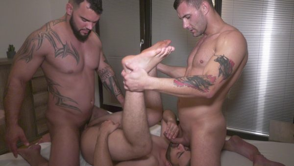 bottom guy lifts up his legs and gets fucked by muscle stud