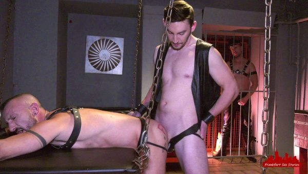 sexy leather stud fucks bold leather guy doggy in a gay club
